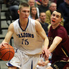Byfield: Danvers High School senior captain Nick Bates drives past Whittier Tech senior Nathan Frongillo, right, in the third quarter of play on Tuesday evening. Bates scored 19 points helping the Falcons return to the D3 North Final with a 69-51 win over the Wildcats at Triton Regional High School. David Le/Salem News