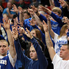Worcester: Danvers High School seniors Joe Strangie, Dan McKenna, and Ray Arocho, lead the fan section by putting their hands in the air for a free throw attempt from senior Eric Martin late in Saturday's D3 State Championship game. David Le/Salem News