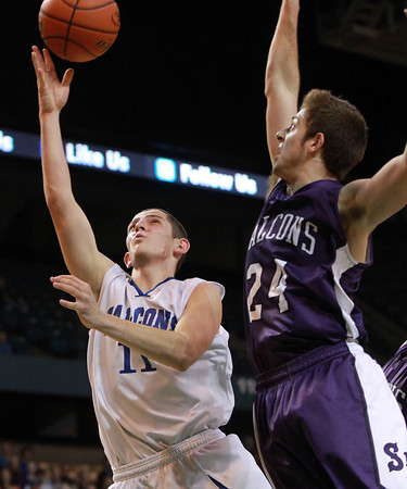 Worcester: Danvers senior Eric Martin floats a layup over the block attempt from Smith Academy's Mathew Sulda, right, for two of his 11 points. Martin and the Falcons repeated as D3 State Champions with a decisive 66-50 win over Smith Academy at the DCU Center in Worcester on Saturday afternoon. David Le/Salem News