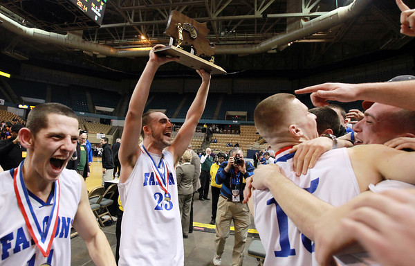 Worcester: Danvers senior captains Eric Martin, left, and Nick Bates, right, jump into the waiting arms of a frenzied Danvers fans while senior captain Nick McKenna holds up the D3 State Championship trophy for all to see. David Le/Salem News