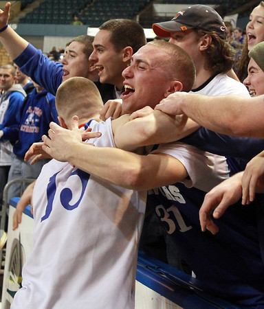 Worcester: Danvers senior captain Nick Bates, left, jumps into the arms of senior classmate Joe Strangie after the Falcons repeated as D3 State Champions with a 66-50 win over Smith Academy on Saturday afternoon at the DCU Center in Worcester. David Le/Salem News