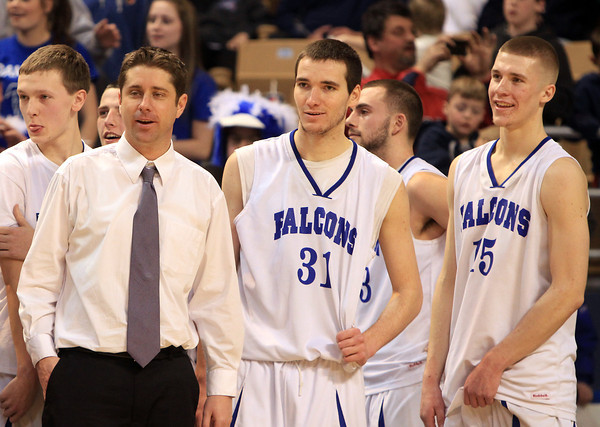 Worcester: Danvers Head Coach John Walsh led his team to its second State Championship in as many years. Walsh stands with senior captains Dan Connors (31) and Nick Bates (15) and watches the final seconds tick away during the Falcons 66-50 win over Smith Academy. David Le/Salem News