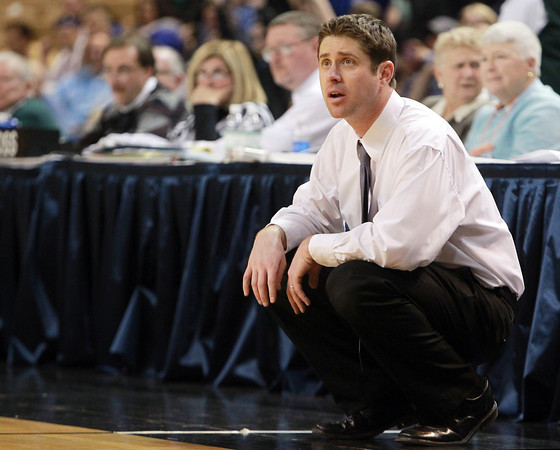 Worcester: Danvers Head Coach John Walsh watches the action on the court during the D3 State Championship at the DCU Center in Worcester. The Falcons took home their second State Title in as many years with a decisive 66-50 win over Smith Academy. David Le/Salem News