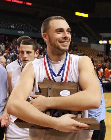 Worcester: Danvers senior captain Nick McKenna hugs the D3 State Championship trophy close to his chest after the Falcons earned their second State Title in as many years with a 66-50 victory over Smith Academy. David Le/Salem News