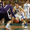 Worcester: Danvers senior captain Eric Martin tightly guards Smith Academy junior Derek McMahon during the first quarter of play. David Le/Salem News