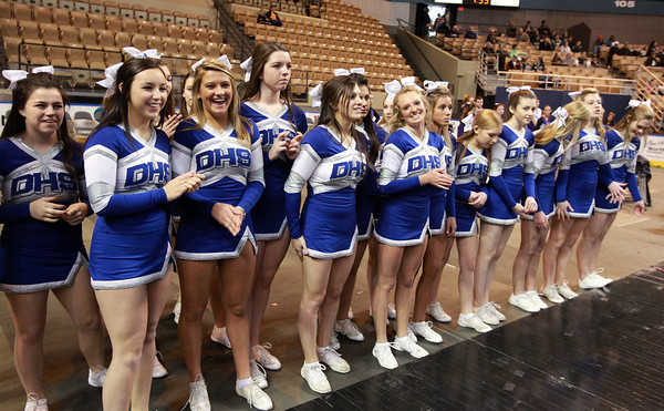 Worcester: The Danvers High School cheerleaders wait on the edge of the court at the DCU Center in Worcester as time ticks down on the Falcons 66-50 win over Smith Academy to capture their second D3 State Championship in as many years. David Le/Salem News