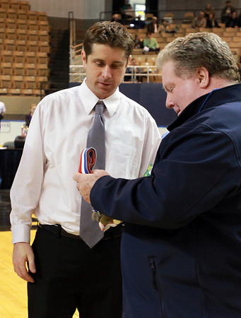 Worcester: Danvers Head Coach John Walsh led his team to its second State Championship in as many years. He waits to receive his individual medal from Danvers Athletic Director John Sulivan. David Le/Salem News