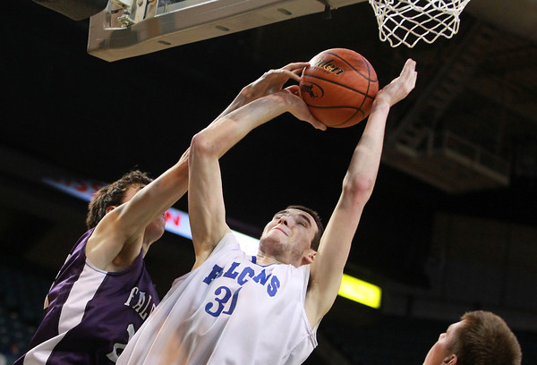 Worcester: Danvers senior captain Dan Connors gets fouled while going up strong to the hoop. Connors scored 12 points to help lead the Falcons to a 66-50 win over Smith Academy in the D3 State Finals on Saturday afternoon. David Le/Salem News