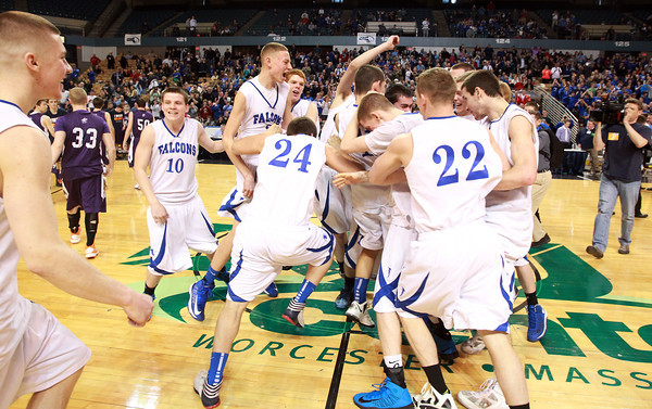 Worcester: The Danvers High School boy's basketball team storms the court at the DCU Center in Worcester as they repeated as D3 State Champions with a 66-50 win over Smith Academy. David Le/Salem News