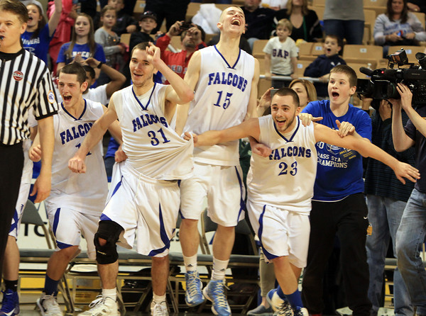 Worcester: Danvers senior captains Eric Martin, Dan Connors, Nick Bates, and Nick McKenna, as well as ball-boy Shane Smith, can barely hold back the excitement as the final seconds expire on the Falcons 66-50 win over Smith Academy in the D3 State Championship game. The Falcons, led by their four senior captains, brought home their second State Title in as many years, the first team in the Salem News coverage area to do so. David Le/Salem News