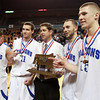 Worcester: Danvers senior captains Eric Martin, Dan Connors, Nick McKenna, and Nick Bates with Head Coach John Walsh, pose for a photo with the D3 State Championship trophy after defeating Smith Academy 66-50 on Saturday afternoon. David Le/Salem News