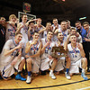 Worcester: The Danvers Falcons pose with the D3 State Championship trophy on the hardwood at the DCU Center in Worcester. Danvers repeated as D3 State Champions with a 66-50 win over Smith Academy. David Le/Salem News