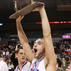 Worcester: Danvers senior captain Nick McKenna screams in celebration and holds the D3 State Championship trophy high above his head after the Falcons repeated as State Champions with a 66-50 win over Smith Academy. David Le/Salem News