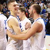 Worcester: Danvers senior captains Nick Bates, left, and Nick McKenna, right, congratulate each other after the Falcons defeated Smith Academy 66-50 to repeat as D3 State Champions. David Le/Salem News