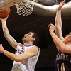 Worcester: Danvers senior captain Dan Connors lays the ball in off the glass after beating Smith Academy sophomore David Longstreeth on a reverse move under the hoop. The Danvers Falcons repeated as D3 State Champions with a 66-50 win over the Smith Academy Falcons on Saturday afternoon at the DCU Center in Worcester. David Le/Salem News