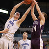 Worcester: Danvers senior captain Nick Bates grabs one of his 17 rebounds away from Smith Academy's Mathew Sulda, right, during the third quarter of play. In addition to 17 boards, Bates added 12 points and 2 blocks to help guide the Falcons to back-to-back D3 State Championships with a 66-50 win over Smith Academy. David Le/Salem News