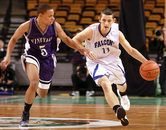 Boston: Danvers senior point guard Eric Martin drives past Martha's Vineyard senior Brandon Watkins while bringing the ball up-court in the D3 State Semi-Final on Tuesday afternoon. David Le/Salem News