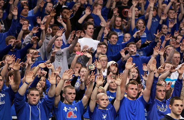 Boston: Danvers fans raise their hands in the air during a free throw attempt from senior Nick Bates. The Falcons advanced to the D3 State Final, looking to defend their state championship, with a 50-47 win over Martha's Vineyard on Tuesday afternoon. David Le/Salem News