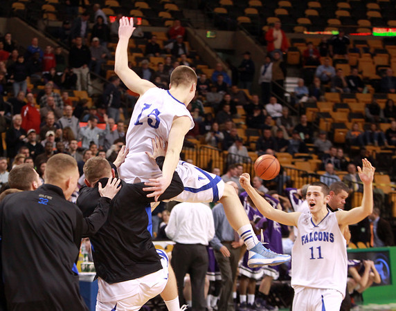 Boston: Danvers senior Nick Bates jumps high in the air and starts to celebrate with teammate Eric Martin after the Falcons defeated Martha's Vineyard 50-47 on Tuesday afternoon. David Le/Salem News