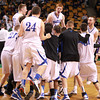 Boston: The Danvers High School boy's basketball team storm the court after defeating Martha's Vineyard 50-47 in the D3 State Semi-Final to advance to their second straight  D3 Final. David Le/Salem News