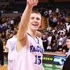 Boston: Danvers senior captain Nick Bates points up into the stands following a 50-47 Falcons win on Monday afternoon at the TD Garden in Boston. David Le/Salem News