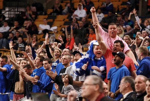 Boston: Danvers High School fans explode in cheers after senior Nick McKenna hit two late free throws to put the Falcons up 50-47, and sealing a Falcons win. Danvers returns to the D3 State Championship game looking to defend last years State Title. David Le/Salem News