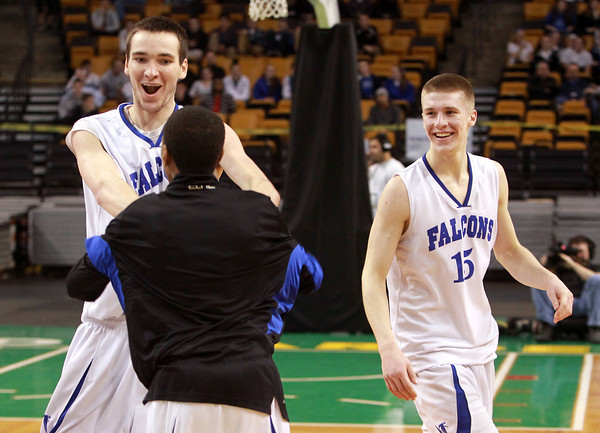 Boston: Danvers senior captains Dan Connors and Nick Bates celebrate a 50-47 win over Martha's Vineyard with freshman Kenneth Crittendon, on the parquet at the TD Garden. David Le/Salem News