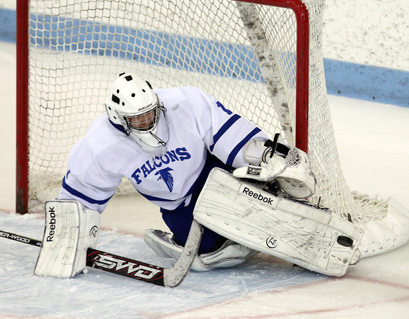 North Billerica: Danvers sophomore goalie Alex Taylor stacks his pads and makes a sliding save against Concord-Carlisle on Monday evening. Taylor made 24 saves and helped lead the Falcons to a 5-3 win over the Patriots in the D2 North semi-final at Chelmsford Forum. David Le/Salem News