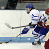 North Billerica: Danvers senior winger Adam Merry wheels with the puck in the corner against Concord-Carlisle on Monday evening. Merry scored a goal and added an assist to help the Falcons take down the Patriots 5-3 at Chelmsford Forum to advance to the D2 North Final. David Le/Salem News