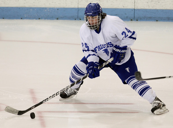 North Billerica: Danvers senior winger Adam Merry dances through the offensive zone with the puck during the third period of play on Monday evening. David Le/Salem News