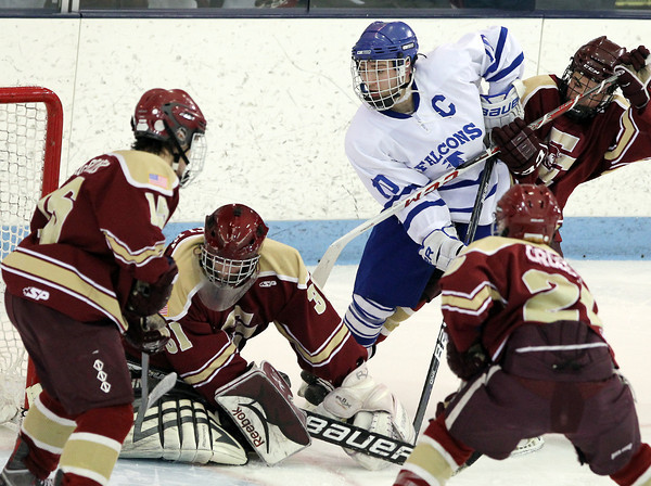 North Billerica: Danvers senior captain Joe Strangie, center, battles for position in front of the Concord-Carlisle net while surrounded by several Patriot defenders. David Le/Salem News