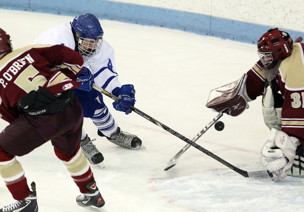 North Billerica: Danvers High School junior forward Matt Flynn tries to poke the puck past Concord-Carlisle goalie Ranger Beguelin during the first period of play on Monday evening. David Le/Salem News