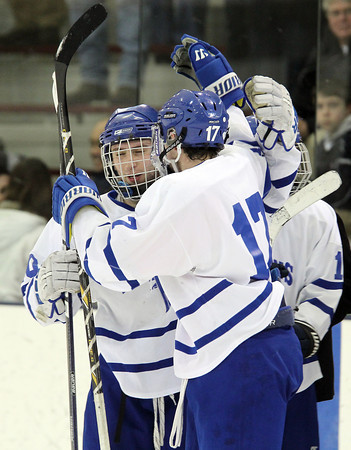North Billerica: Danvers senior captains Joe Strangie, left, and AJ Couto, celebrate after the Falcons 5-3 victory over Concord-Carlisle on Monday evening in the D2 North semi-final game at Chelmsford Forum. The Falcons will take on defending D2 State Champion Wilmington in the D2 North Final next Monday at Tsongas Arena. David Le/Salem News
