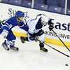 Lowell: Danvers sophomore Stephen Ganley, left, stick checks the puck away from Wilmington freshman Billy Falter during the third period of play on Monday evening. David Le/Salem News