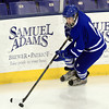 Lowell: Danvers junior forward Matt Flynn carries the puck along the boards against Wilmington on Monday evening. David Le/Salem News