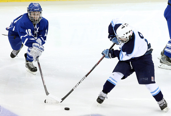 Lowell: Danvers senior Joe Strangie reaches out and ties up the stick of Wilmington senior Cam Collins, and steals the puck. David Le/Salem News