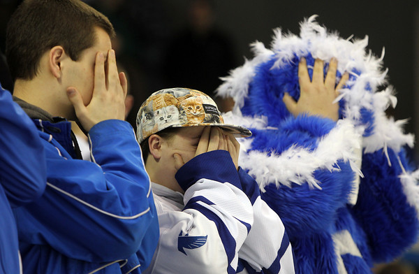 Lowell: Danvers High School fans cover their faces as Wilmington is introduced prior to the start of the D2 North Final at the Tsongas Center in Lowell on Monday evening. David Le/Salem News