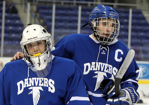 Lowell: Danvers senior captain Rob Buchanan puts an arm around sophomore goalie Alex Taylor after the Falcons fell 7-2 to Wilmington in the D2 North Finals on Monday evening. David Le/Salem News