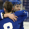 Lowell: Tearful senior captain Rob Buchanan, right, hugs junior teammate and assistant captain Kevin Hodgkins after the Falcons fell 7-2 to Wilmington in the D2 North Final on Monday evening at the Tsongas Center in Lowell. David Le/Salem News