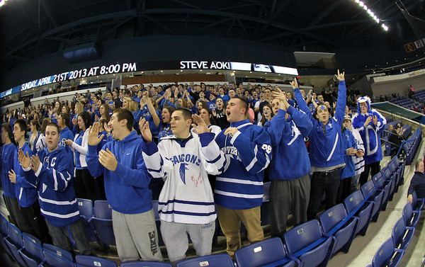 Lowell: The Danvers High School fan section cheer loudly as the Falcons take the ice for the D2 North Final on Monday evening. David Le/Salem News