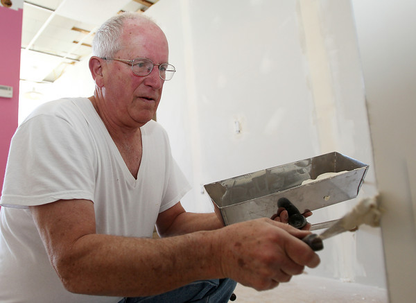 Beverly: A new day center for Family Promise North Shore Boston, is opening on Rantoul St. in Beverly. Bob Prichard, of Rockport, from the Congregational Church of Essex works on Saturday morning to spackle the walls of the new center for its scheduled opening on May 12th. David Le/Salem News