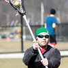 Beverly: Hamilton resident Scott Myers plays catch with a lacrosse ball at Beverly High School on a warm Wednesday afternoon. David Le/Salem News