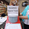 "Peabody: Skippy, the house cat at Northeast Veterinary Hospital on Lowell St. in Peabody, peers over the top of the ""Keeno"" Fund Donations jar that sits on the counter inside the clinic. David Le/Salem News"
