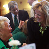 Peabody: State Senator Joan Lovely, right, chats with Peabody resident Loretta Tenaglia, left, at a St. Pat's Day roast at City Hall on Saturday morning. David Le/Salem News