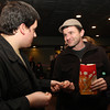 "Salem: Sean McCrea, right, of Salem, hands his ticket to Cinema Salem employee Nick Henry on his way into see ""West of Memphis,"" a new film about the West Memphis Three including current Salem resident Damien Echols, at the Salem Film Fest on Friday evening. David Le/Salem News"