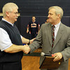 Middleton: Superintendent of the North Shore Regional Vocational School District, Dan O'Connell, right, shakes hands with former North Shore Tech Athletic Director John Lynch after dedicating the NST gymnasium in his name and presenting him with a plaque. David Le/Salem News