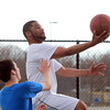Danvers: Victor Sunderland, 22, of Peabody, goes up for a layup while playing pickup basketball at Plains Park in Danvers on Friday afternoon. David Le/Salem News