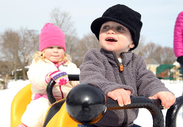 Beverly: Asher Stern, 2 1/2, and Abby Elisabeth Schad, 3, both of Beverly, sit and swing back and forth on a bumblebee at the Kimball Haskell Playground on Monday afternoon. David Le/Salem News