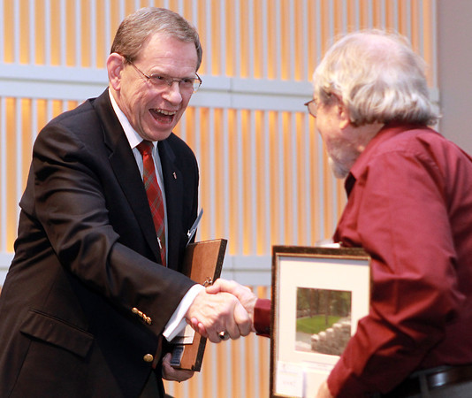 Salem: Thomas Doyle, left, shakes hands with fellow Salem Award Recipient Horace Seldon, right, after receiving the honor on Tuesday evening at the Peabody Essex Museum on Tuesday evening. David Le/Salem News