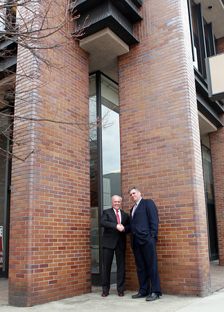 Lynn: North Shore Community College will be opening a new extension campus in downtown Lynn at the corner of Union and Silsbee Streets. The new building will house the college's culinary and cosmetology programs. North Shore CC President Wayne Burton, left, and Vice-President for Higher Education Partners, Bill Luster, right, stand outside the building on Friday morning. David Le/Salem News